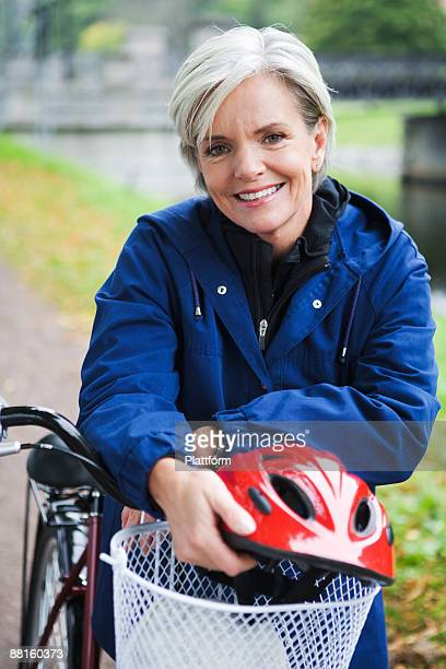 female cyclist in a park stockholm sweden. - northern european descent stock pictures, royalty-free photos & images