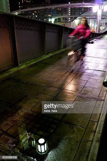 Female cyclist on her way home