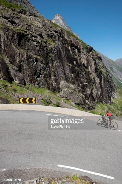Female cyclist on the Trolstiggen Pass, Norway.