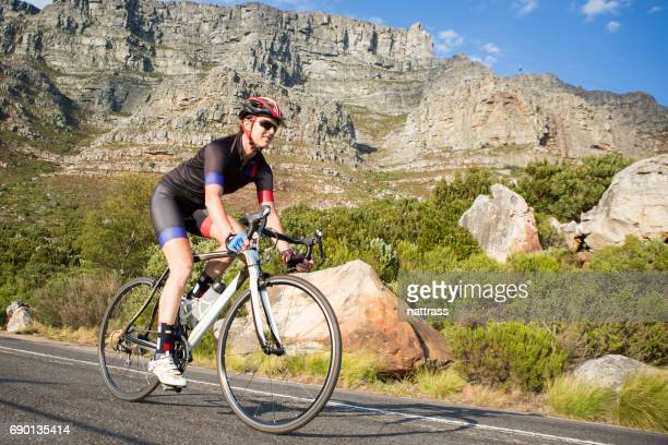 female cyclist out on a training ride on her road bike - cycling event stock pictures, royalty-free photos & images