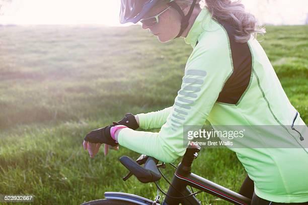 Female cyclist using smart watch