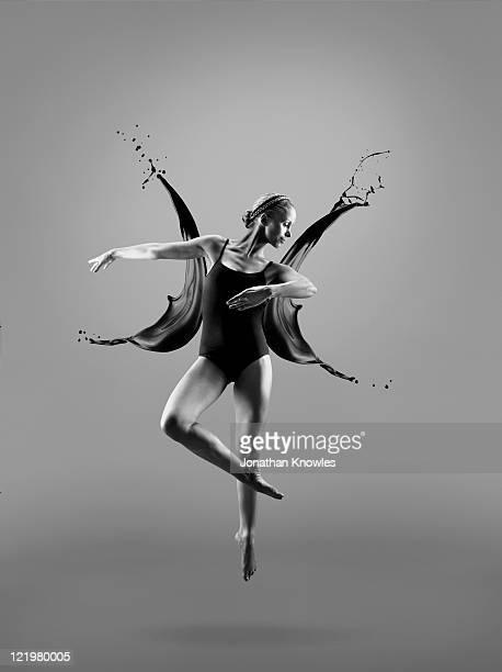 Female dancer and liquid splashes