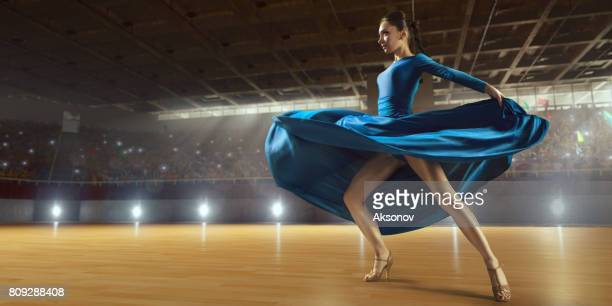female dancer ardently perform the latin american dance on a large professional stage - cha cha stock photos and pictures