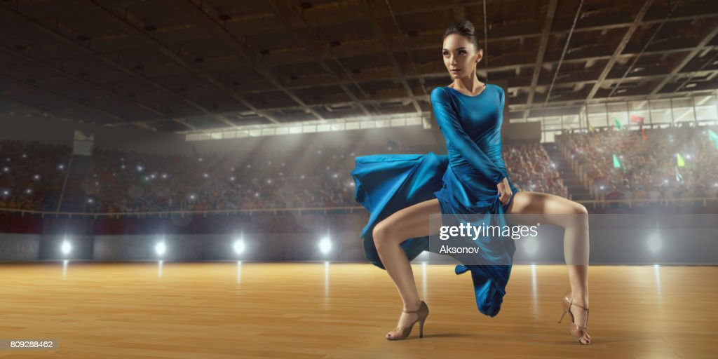 Female dancer ardently perform the latin american dance on a large professional stage : Stock Photo