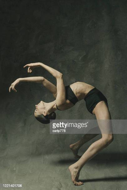 female dancer bending backwards - alternative pose stock pictures, royalty-free photos & images