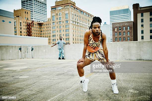 female dancer dancing on rooftop - black skirt stock pictures, royalty-free photos & images