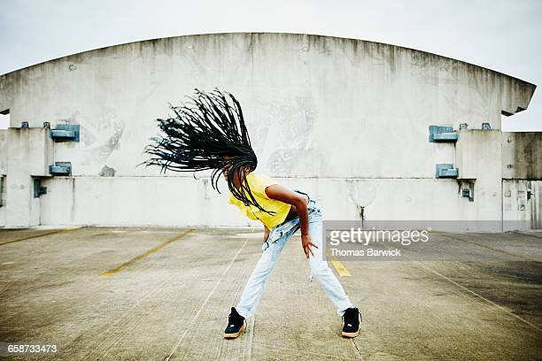 Female dancer flipping hair while dancing