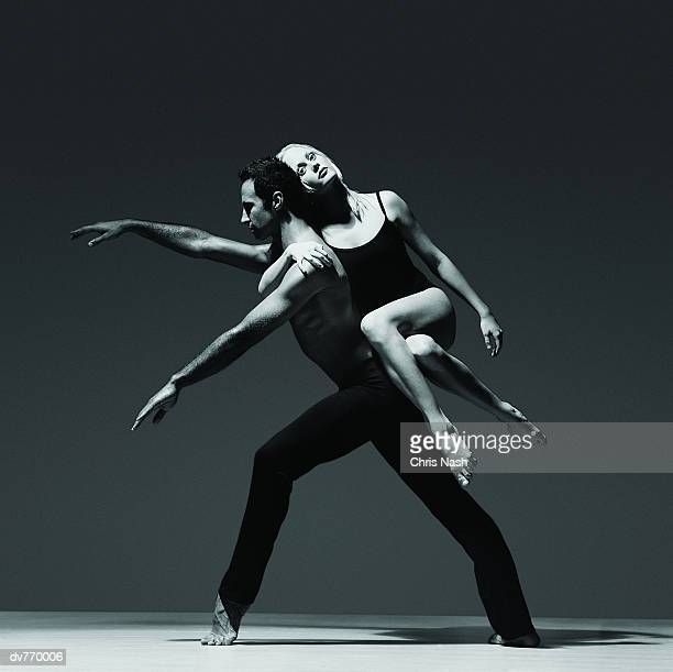 Female Dancer Holding Onto the Back of a Male Dancer