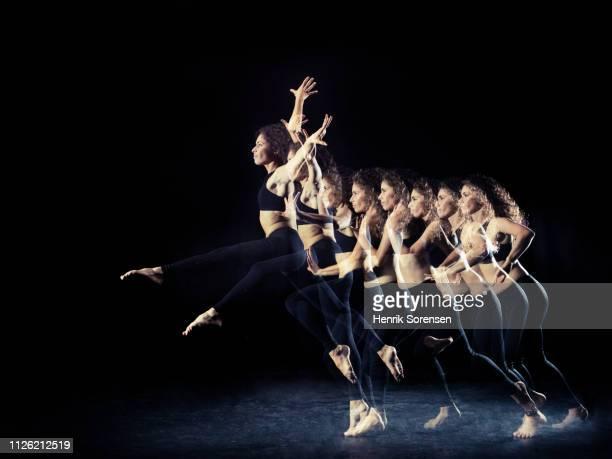 female dancer in multiple motion - gymnastique au sol photos et images de collection