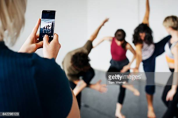 Female dancer taking pictures of her friends