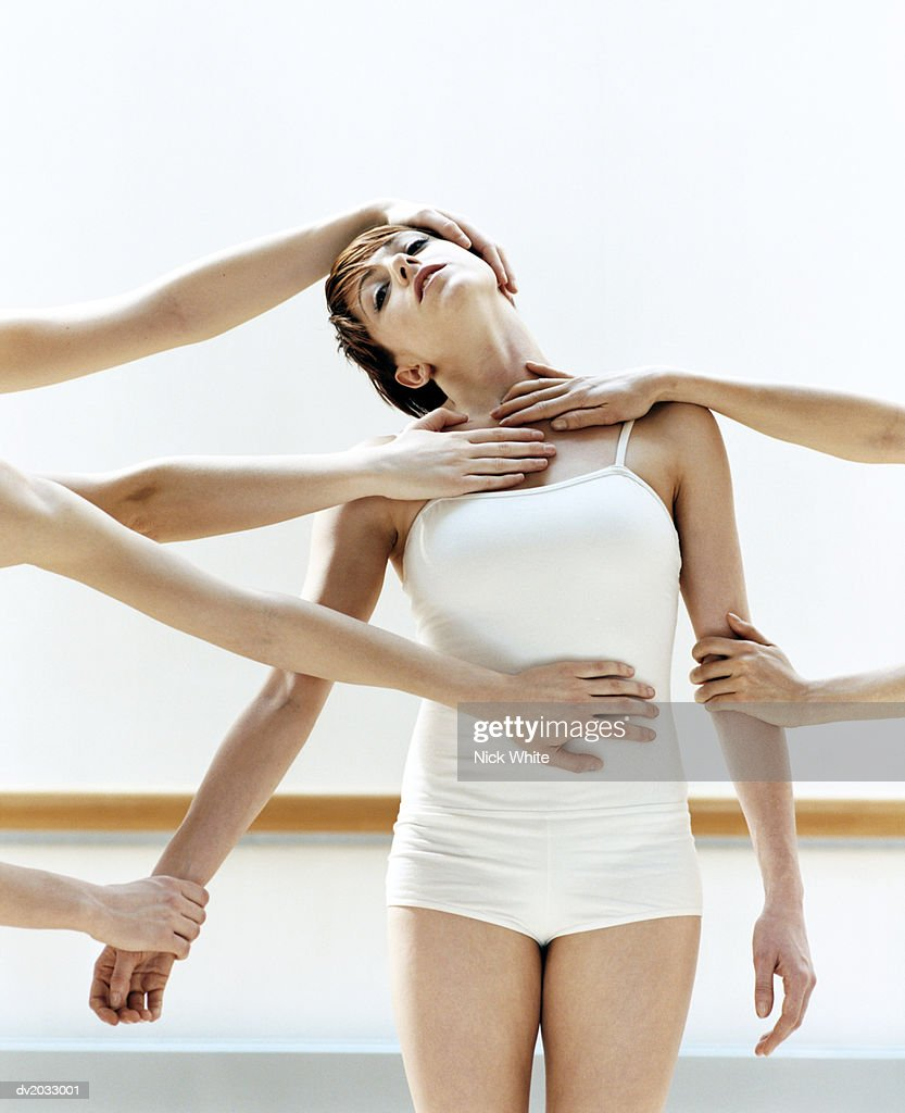 Female Dancer With Hands Touching Her : Stock Photo