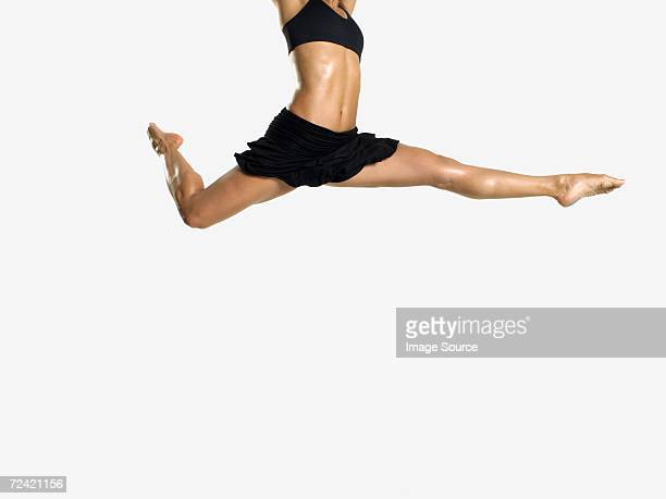 Female dancers legs jumping