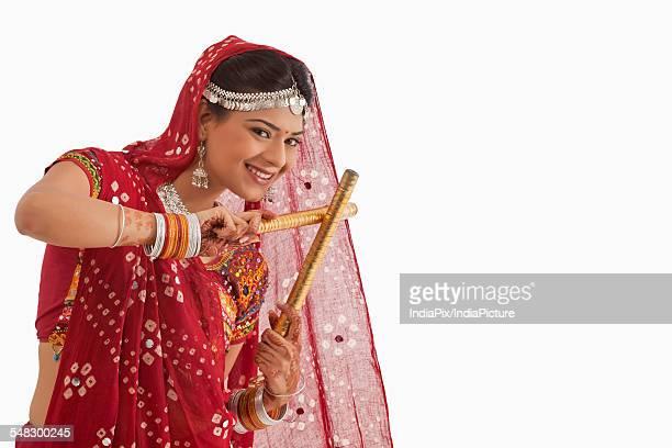 Female dandiya dancer dancing with sticks