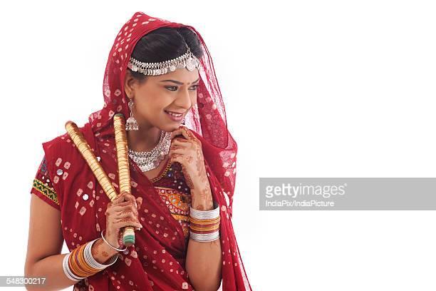 Female dandiya dancer with sticks