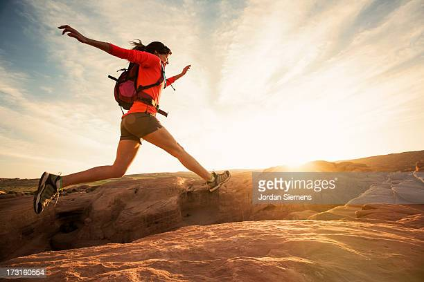 a female dayhiking in arches park. - extreme sports stock pictures, royalty-free photos & images