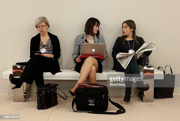 Female delegates take a break during sessions on day two of the World Economic Forum in Davos Switzerland on Thursday Jan 24 2013 World leaders...
