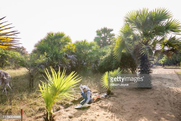 Female de-miner works to clear mines in Muhamalai, one of the biggest minefields in the world, on March 3, 2019 in Muhamalai, Sri Lanka. As the 10...