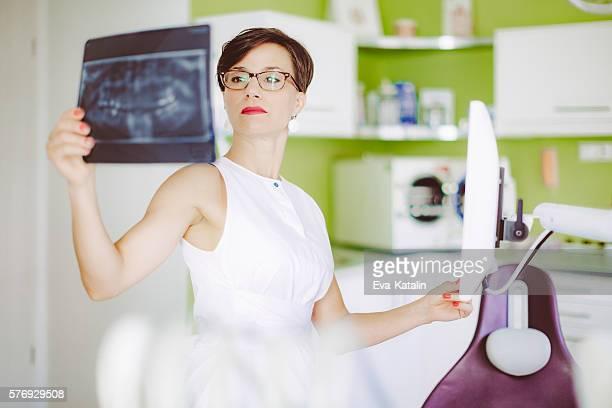 Female dentist is working