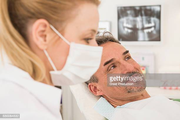 Female dentist with happy patient in dental clinic, Munich, Bavaria, Germany