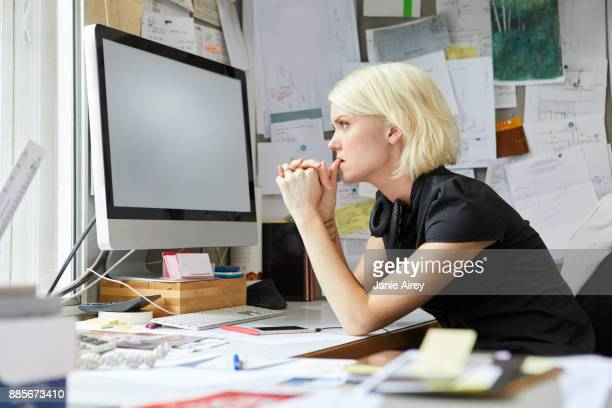 Female designer staring from office desk