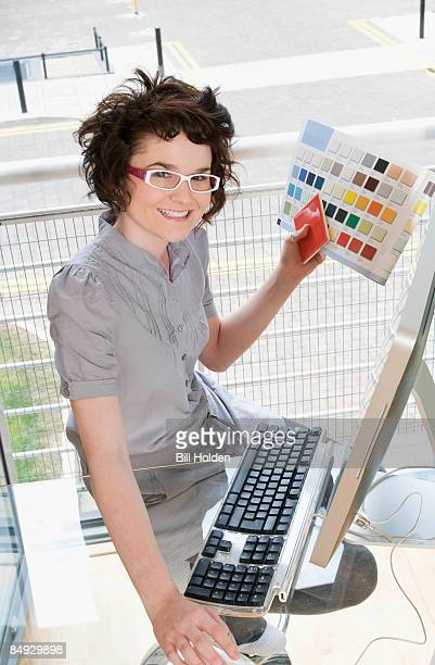 Female designer working at her computer