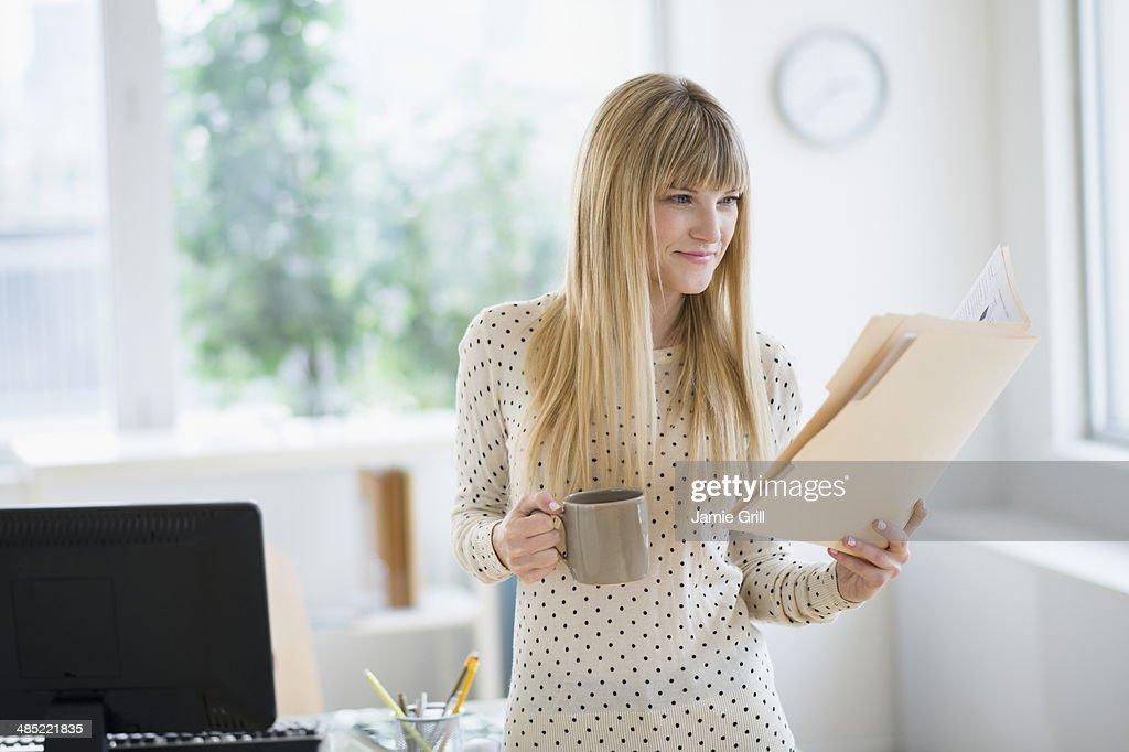 Female designer working in office : Stock Photo