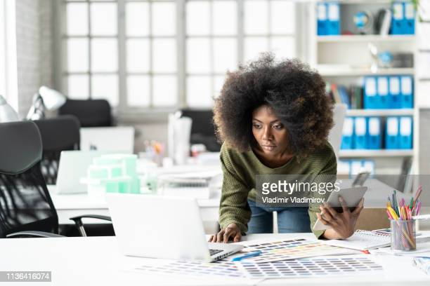 female designer working in studio - graphic designer stock pictures, royalty-free photos & images