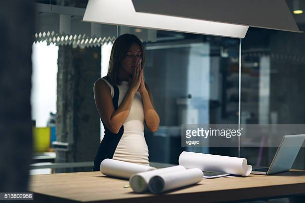Female Designer Working Under Pressure In Her Office.