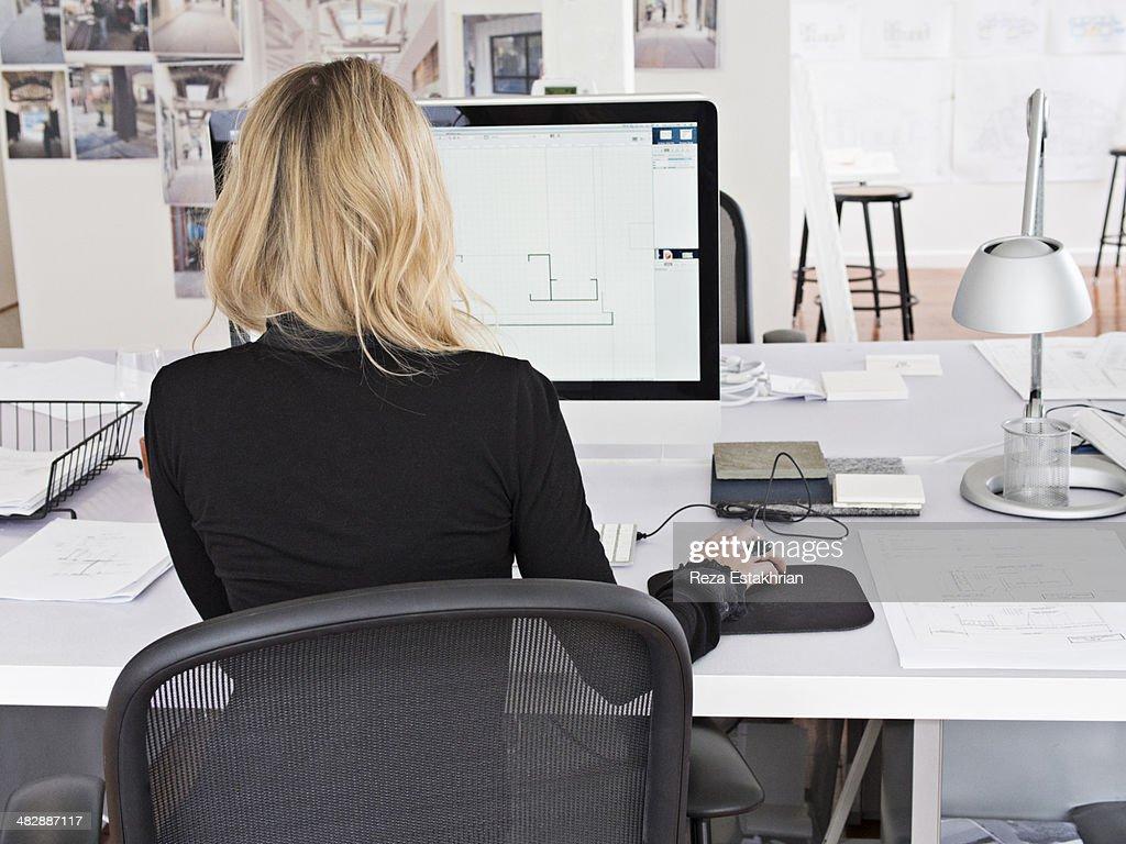 Female designer works on computer : Stock Photo