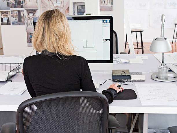female designer works on computer picture