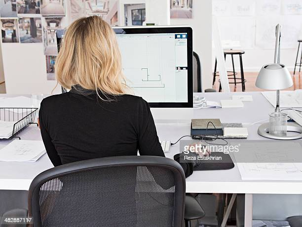 female designer works on computer - back to work stock pictures, royalty-free photos & images