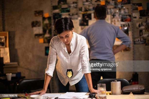 female detective working late at fbi office - criminal investigation stock pictures, royalty-free photos & images
