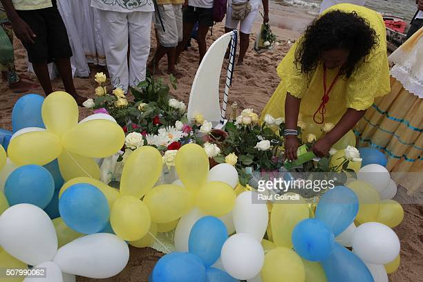 Female devotee adorns gifts to be thrown at sea as offerings to Yemanja at Rio Vermelho beach to celebrate Yemanja day on February 2 2016 in Salvador...
