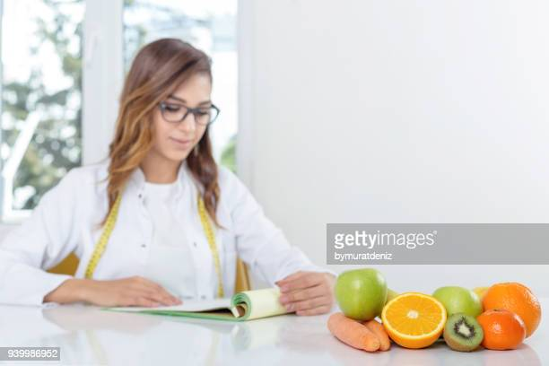 female dietician with vegetables and fruit - nutritionist stock pictures, royalty-free photos & images