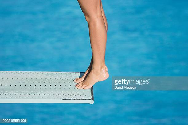 female diver standing on edge of diving board, low section - madison grace stock pictures, royalty-free photos & images