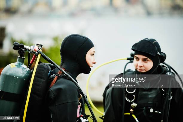 Female divers in discussion before open water dive