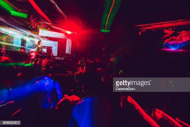 Female DJ Artist Mixing Music at Techno Party