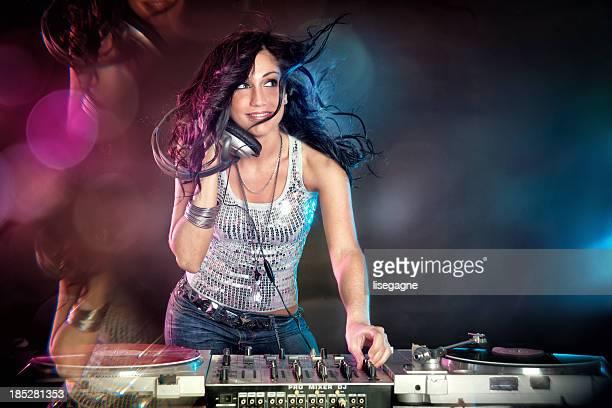 Female DJ playing music and dancing