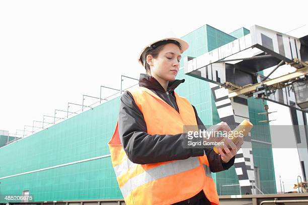 female dockworker using monitor - sigrid gombert stock pictures, royalty-free photos & images