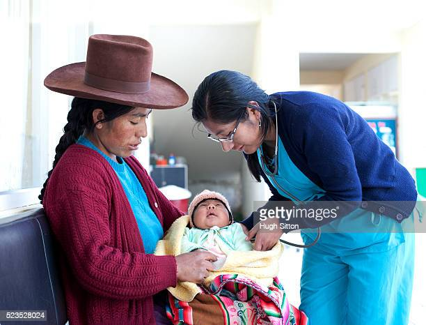 female doctor and nurse with patient in hospital. peru - developing countries stock pictures, royalty-free photos & images