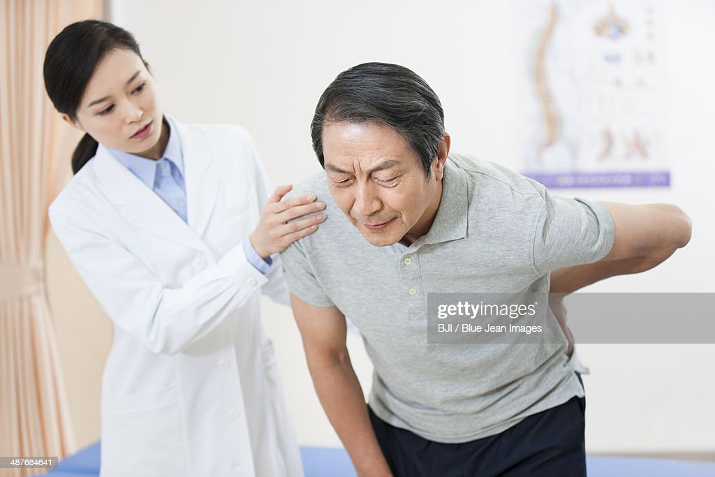 Female doctor and senior patient : Stock Photo