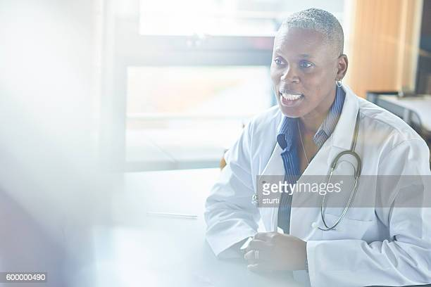 female doctor chatting to patient