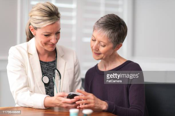 female doctor consults diabetic patient - glucose stock pictures, royalty-free photos & images