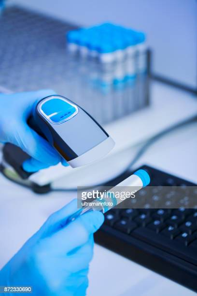 female doctor doing medical research medical samples, at the lab. young woman scientist in laboratory use bar code, bar code reader. women in stem. - blood bank stock pictures, royalty-free photos & images