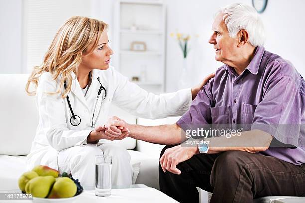 Female doctor examining an elderly patient.