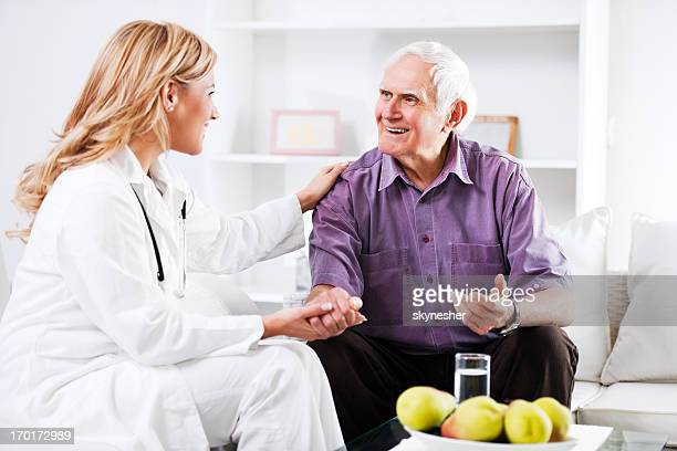 Female doctor examining an elderly patient