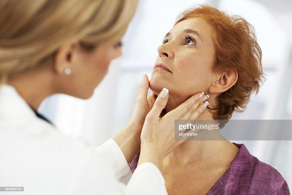 Female doctor examining her patient. : Stock Photo