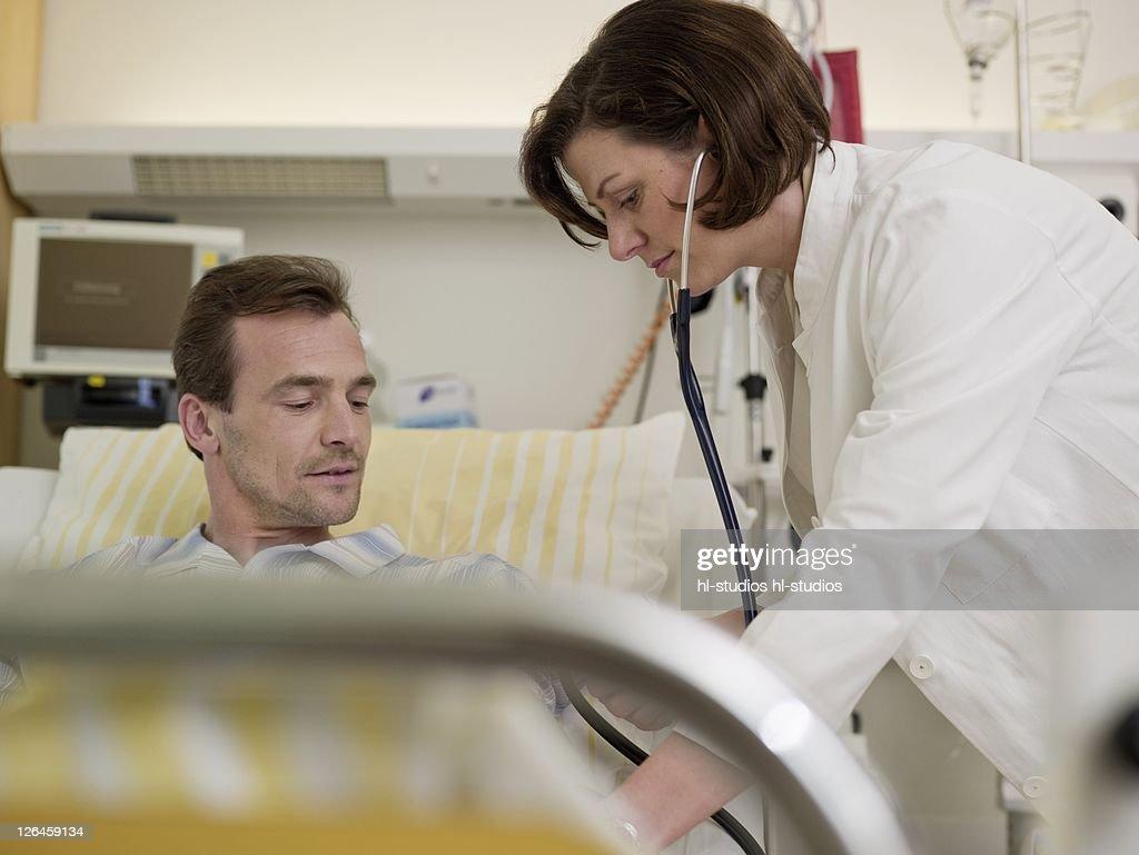 Woman Doctor Examining Man