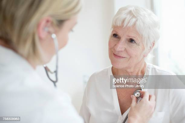 Female doctor examining senior woman