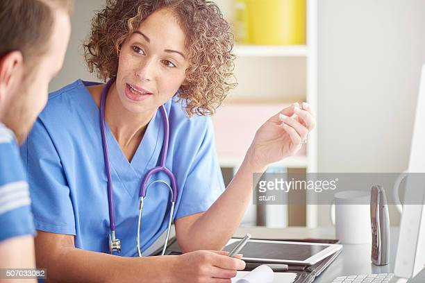 female doctor explaining to patient .